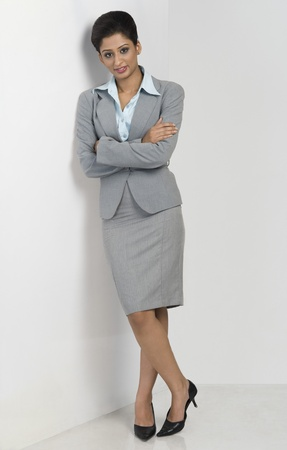 Portrait of a businesswoman leaning against a wall Stock Photo - 10168219