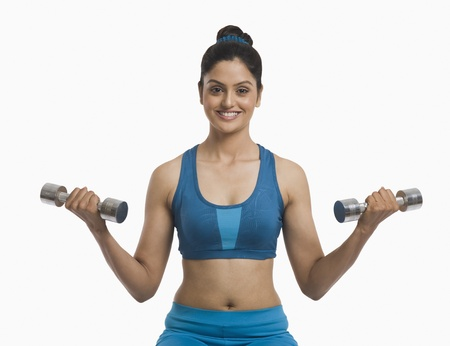 Woman exercising with dumbbells Stock Photo - 10166792