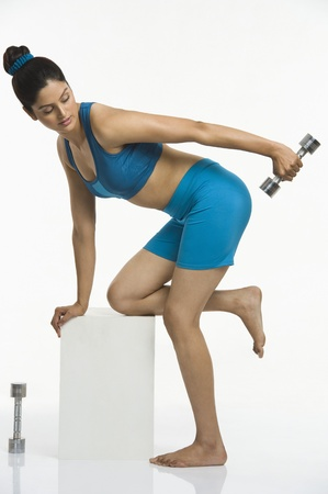 Woman exercising with dumbbells Stock Photo - 10168667