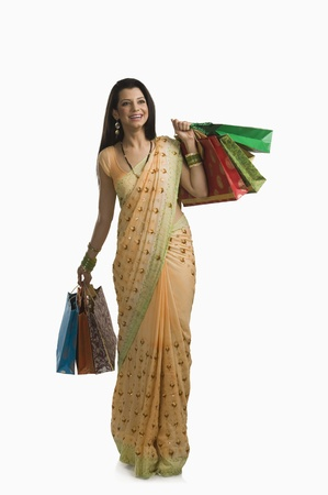 Woman holding shopping bags Stock Photo - 10166825