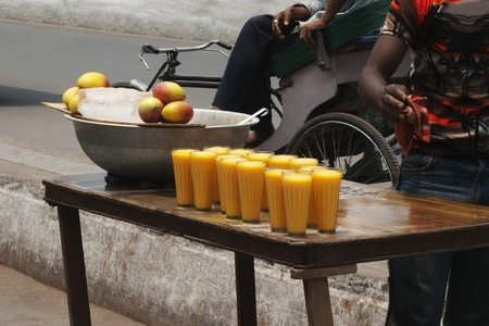 Glasses of mango shake at a market stall, New Delhi, India photo
