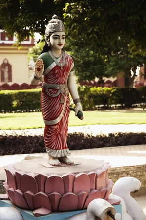 Statue of goddess Lakshmi in the garden of a temple, Lakshmi Narayan Temple, New Delhi, India photo