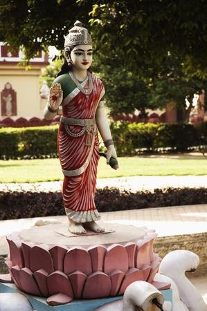 Statue of goddess Lakshmi in the garden of a temple, Lakshmi Narayan Temple, New Delhi, India Stock Photo - 10206410