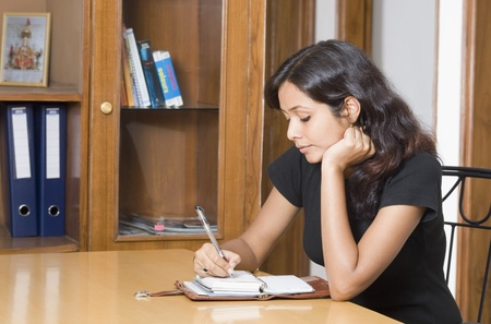 Woman studying in a room Stock Photo
