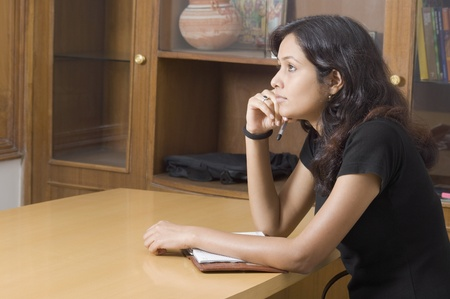 Woman studying and thinking in a study room Stock Photo - 10205517