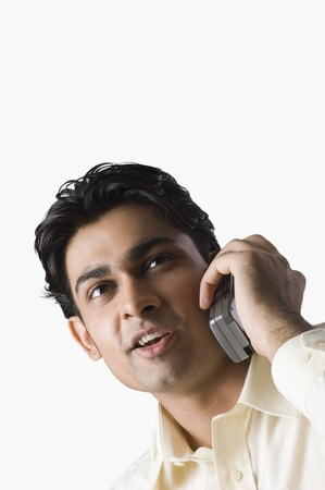 Close-up of a man talking on a mobile phone photo