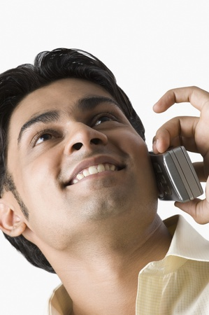 telecommunicating: Close-up of a man talking on a mobile phone