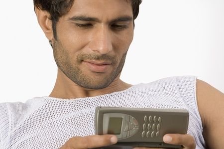 telecommunicating: Close-up of a man text messaging on a mobile phone