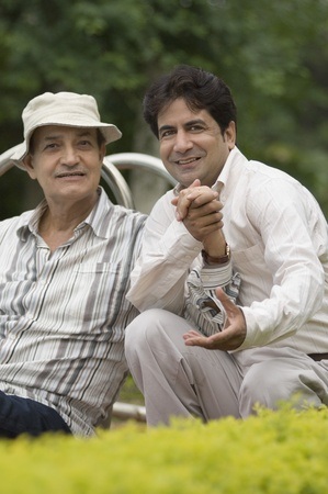 Portrait of a man with his father in a park Stock Photo