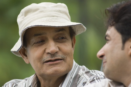 Close-up of a man with his father in a park photo