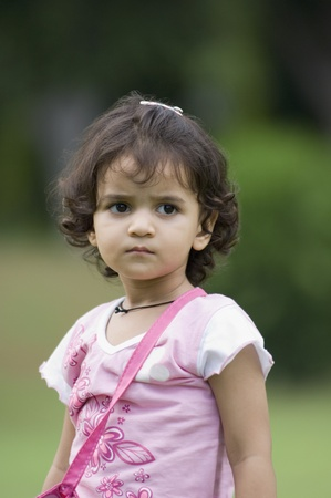 Close-up of a girl in a park Stock Photo
