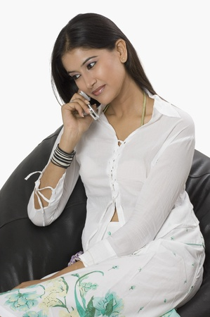 telecommunicating: Woman talking on a mobile phone