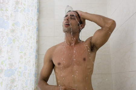 bathing man: Close-up of a man taking a shower