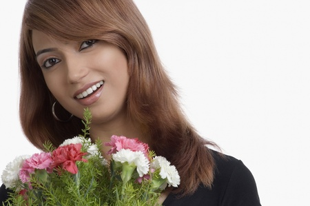 Portrait of a woman holding bouquet of Carnation flowers Stock Photo - 10205300