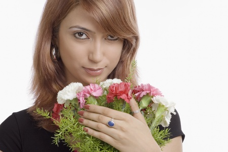 Portrait of a woman holding bouquet of Carnation flowers photo
