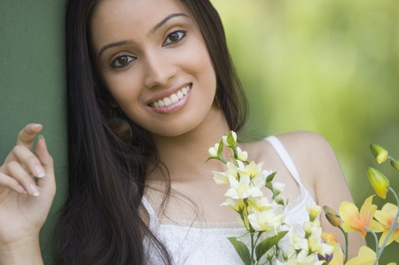 Portrait of a teenage girl with bouquet of flowers photo