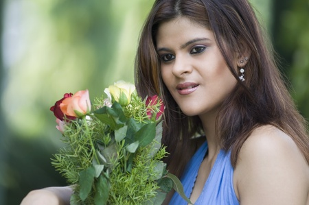 Displeased woman holding bouquet of Rose flowers