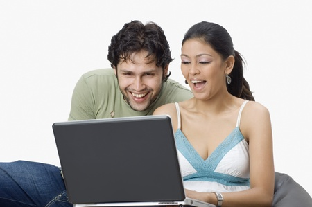 Couple chatting on a laptop photo