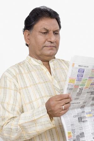 Man reading a newspaper Stock Photo - 10206213