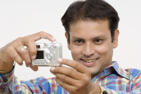 Man taking picture of himself with a digital camera Stock Photo - 10206090