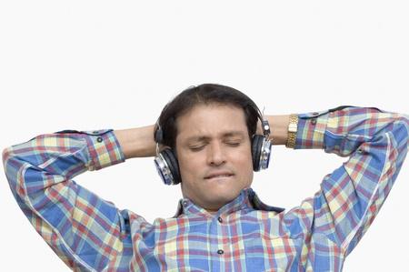 Man listening to music with headphones Stock Photo - 10206337
