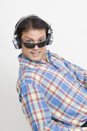 Man listening to music with headphones Stock Photo