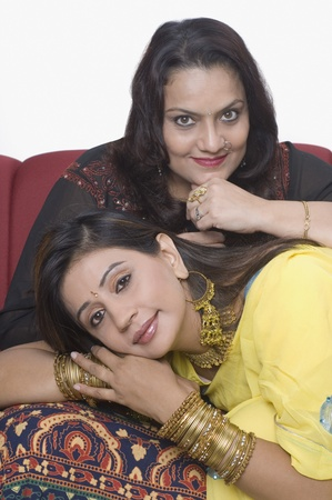 kameez: Woman with her daughter on a couch