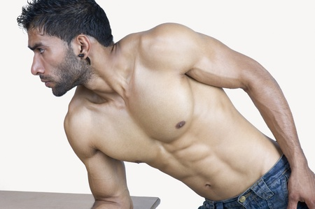physically fit: Close-up of a man flexing muscles
