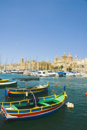 Boats with a church in the background, San Lawrenz Church, Grand Harbor, Birgu, Malta photo