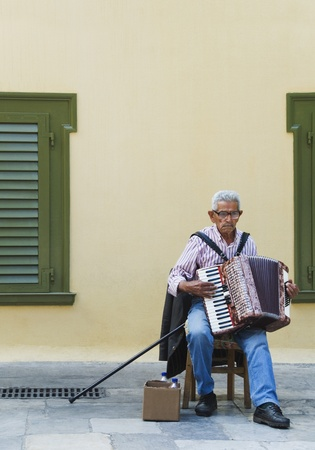 Man playing an accordion, Athens, Greece photo