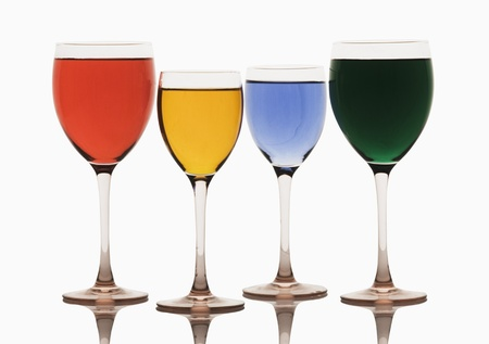 Close-up of assorted cocktails in wine glasses