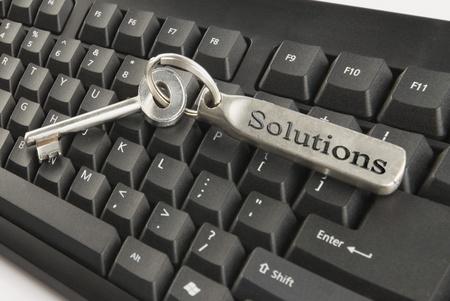photosindia: House key on a computer keyboard Stock Photo