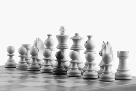 photosindia: Close-up of chess pieces on a chessboard Stock Photo