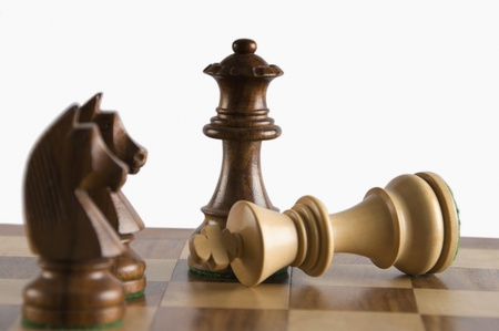 Close-up of chess pieces on a chessboard Banco de Imagens
