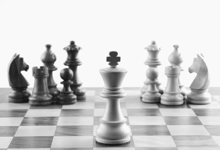 Close-up of chess pieces on a chessboard Imagens