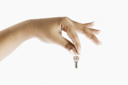 Close-up of a womans hand holding a key photo