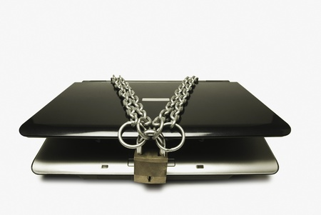 Close-up of a laptop tied with chain and a padlock Stock Photo - 10231785
