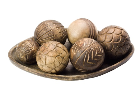 showpiece: Close-up of decorative wooden balls on a tray