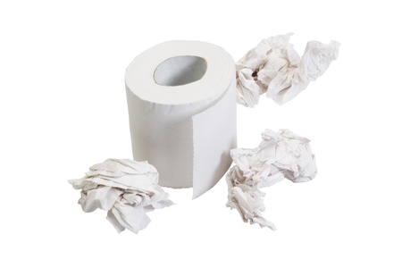 Close-up of a toilet paper roll with crumpled papers