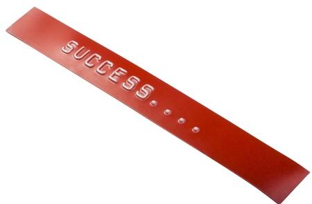 Close-up van het woord succes op een label