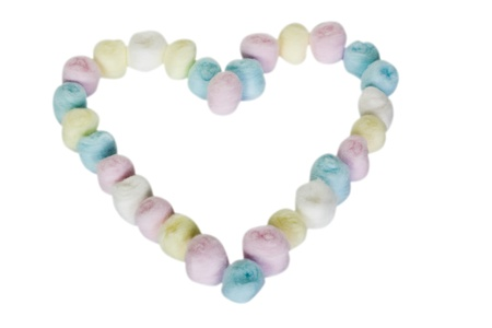 Close-up of a heart shape made from colorful cotton balls