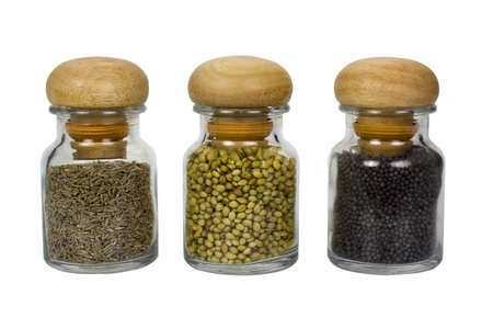 Three containers of assorted spices photo