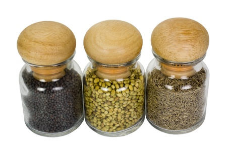 Close-up of spice containers photo