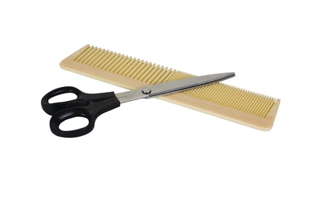 Close-up of a comb with scissors Stock Photo