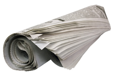 Close-up of a rolled up newspaper