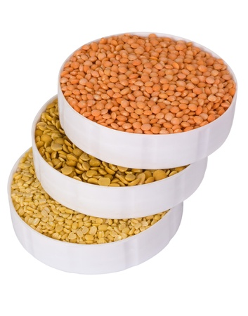 Close-up of a stack of assorted beans in containers photo