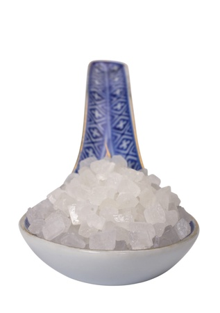 Close-up of a spoon full of crystal sugar photo