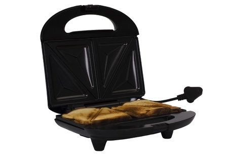 Close-up of a toaster with bread slices photo