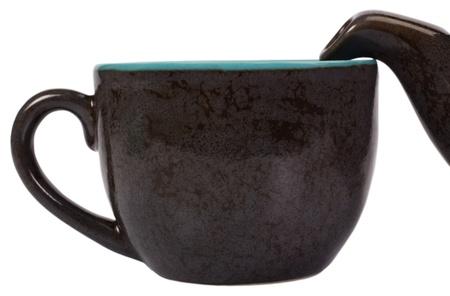 Close-up of a tea kettle with a tea cup Reklamní fotografie