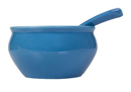 soup spoon: Close-up di una ciotola in ceramica con un cucchiaio da minestra